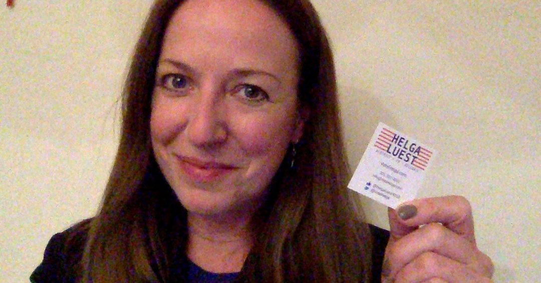 Helga Luest with 2x2 enviro-friendly business card - half the carbon footprint
